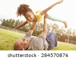 grandfather playing game with... | Shutterstock . vector #284570876