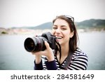 happy woman on vacation... | Shutterstock . vector #284581649