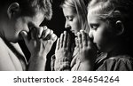 praying family. man  woman and... | Shutterstock . vector #284654264