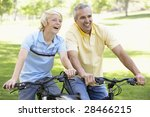 father and son cycling through... | Shutterstock . vector #28466215