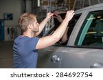 applying tinting foil onto a... | Shutterstock . vector #284692754