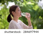 portrait of woman drinking... | Shutterstock . vector #284697944