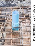 Construction site: PVC sleeve installed in reinforcement bars before pouring concrete slab - stock photo