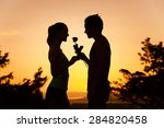 Man Giving Woman A Rose. ...
