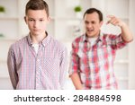father and son dressed casual... | Shutterstock . vector #284884598