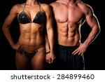 fitness couple poses in studio  ... | Shutterstock . vector #284899460