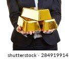 Hands Holding Three Gold Bars...