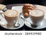 cappuccino with croissant. two... | Shutterstock . vector #284919980