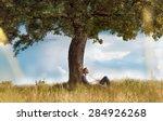 Human Sitting Under Tree. Man...