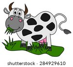 huge cow eating in the field | Shutterstock .eps vector #284929610