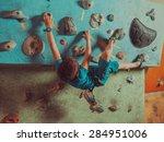 Boy Climbing On Artificial...