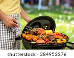 man is grilling meat on... | Shutterstock . vector #284953376