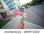 hand holding american flag. | Shutterstock . vector #284971823