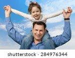 child  father  shoulder. | Shutterstock . vector #284976344