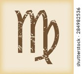 grungy brown icon with virgo...
