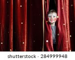 young boy wearing clown make up ... | Shutterstock . vector #284999948