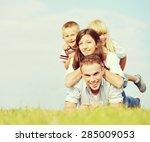 cheerful family on beautiful... | Shutterstock . vector #285009053