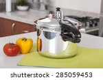 double valve pressure cooker on white background