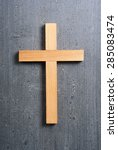wooden cross on rusty black... | Shutterstock . vector #285083474