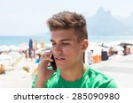 sporty guy in a green shirt at... | Shutterstock . vector #285090980