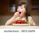 happy little girl eats... | Shutterstock . vector #285113690