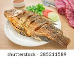 Fried Fish On White Plate And...