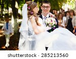 happy groom is holding his... | Shutterstock . vector #285213560