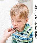boy drinking liquid medicine   Shutterstock . vector #285214139