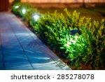 Stock photo small solar garden light lanterns in flower bed garden design solar powered lamp 285278078