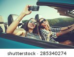 two attractive young women... | Shutterstock . vector #285340274