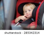 toddler boy sitting in car seat | Shutterstock . vector #285342314