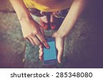 hands using a phone texting on... | Shutterstock . vector #285348080