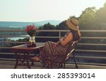 Woman Sitting On Bench At...