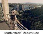 woman standing at balcony... | Shutterstock . vector #285393020