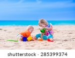 kids play on a beach. children...