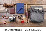 hiking gear on wooden background | Shutterstock . vector #285421310