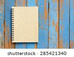Brown Notebook On Wooden...