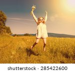 beautiful happy girl jumping at ... | Shutterstock . vector #285422600