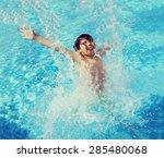 Child Splashing In Summer Wate...