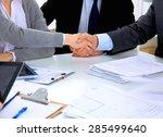 business people shaking hands ... | Shutterstock . vector #285499640