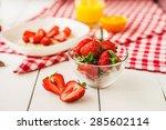 ripe red strawberries on white... | Shutterstock . vector #285602114