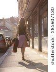 urban girl striding through a... | Shutterstock . vector #285607130