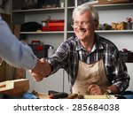 smiling senior carpenter... | Shutterstock . vector #285684038