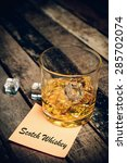 Small photo of scotch whiskey with label on paper note. Glass of scotch whiskey