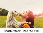 Stock photo girl and dog 285751448