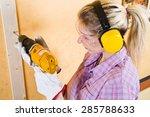 Female Carpenter  At Work Using ...