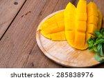 mango slice on wood background | Shutterstock . vector #285838976