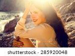 beautiful young girl sitting on ... | Shutterstock . vector #285920048