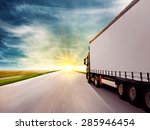Truck Driving Towards Sunset