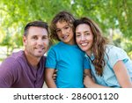 happy family kissing at camera... | Shutterstock . vector #286001120